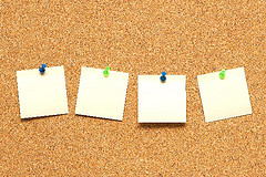 Yellow post it notes on the corkboard