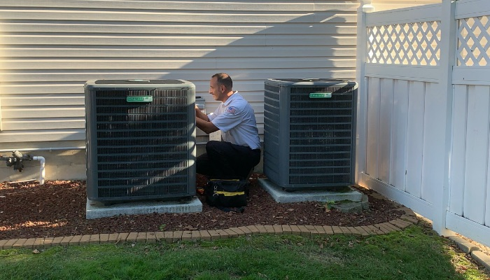 Jerry Kelly Tech Repairing Air Conditioner