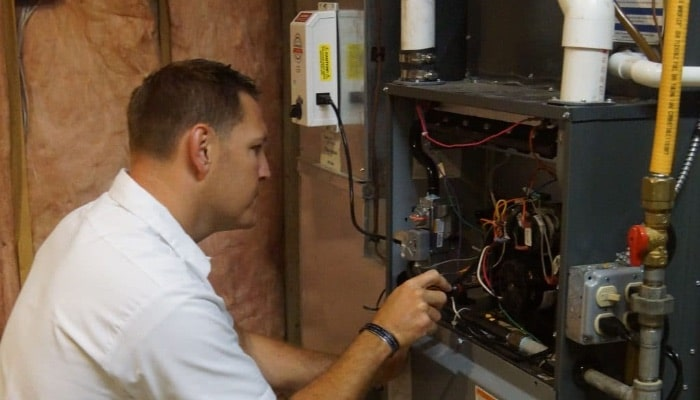 A technician working on a furnace tune-up