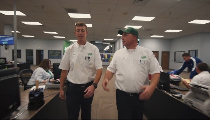 Jerry Kelly Technicians Walking Through The Office